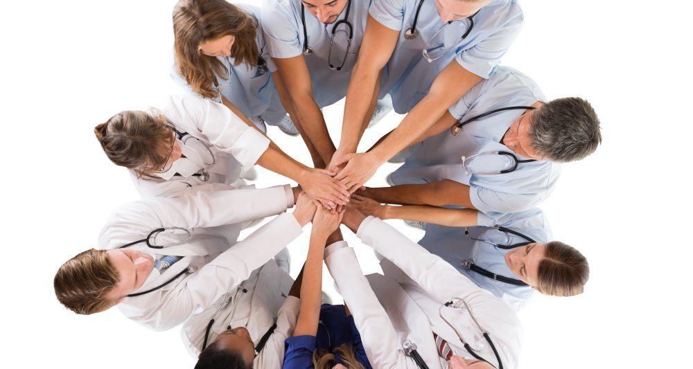 group of medical staff hands together