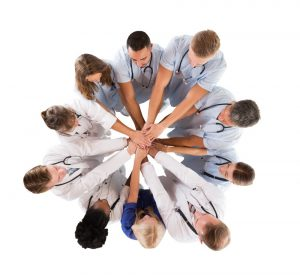 group of medical staff hands together